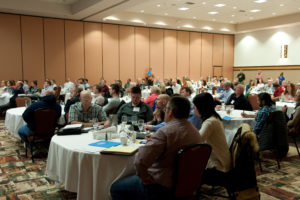 Attendees listening to presentations.