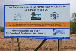 Sign at Royster Clark Property with contact information and list of financial supporters.