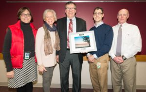 John Robinson (center), EM Division Supervisor of the Year, with (l to r) Darsi Foss, Mary Robinson, Bart Sponseller, Pat Stevens